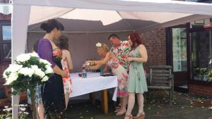In this sand pouring ceremony, gin lovers Aubrey and Stephanie used a gin bottle from a local distillery