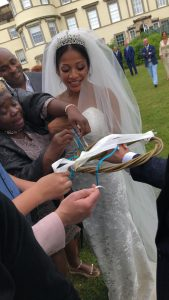 Guests tie their ribbons on at a Bristol wedding