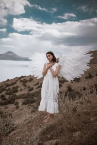 A girl in a white dress with wings
