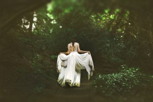 A welsh bride walking into the woods